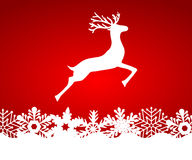Reindeer on red background with snowflakes Stock Photos