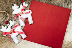 Reindeer with red letter for Christmas Royalty Free Stock Image