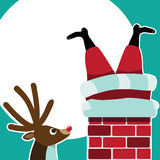 Reindeer sees Santa Claus stuck in the chimney Stock Images