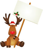Reindeer with signboard Royalty Free Stock Photos