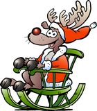Reindeer sitting in rocking chair Stock Photos