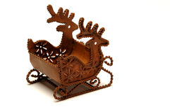 Reindeer and sled. A unique beautiful old christmas ornament of sled pulled by reindeer mad of rusted iron found at a tag sale thrift shop Stock Photography