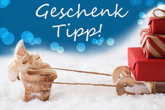 Reindeer With Sled, Blue Background, Geschenk Tipp Means Gift Tip Stock Photos