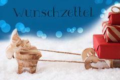 Reindeer With Sled, Blue Background, Wunschzettel Means Wish List Stock Image
