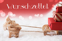 Reindeer With Sled, Red Background, Wunschzettel Means Wish List Stock Image