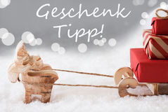 Reindeer With Sled, Silver Background, Geschenk Tipp Means Gift Tip Royalty Free Stock Image
