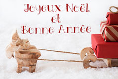 Reindeer With Sled On Snow, Bonne Annee Means New Year Stock Photo