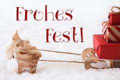 Reindeer With Sled On Snow, Frohes Fest Means Merry Christmas Stock Images