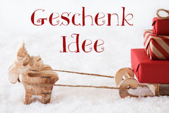 Reindeer With Sled On Snow, Geschenk Idee Means Gift Idea Stock Image