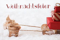 Reindeer With Sled On Snow, Weihnachtsfeier Means Christmas Party Royalty Free Stock Photo