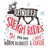 Reindeer sleigh rides signboard. Old fashioned reindeer sleigh rides signboard. Hand-lettering advertising sign. Vintage hand drawn typography with the Royalty Free Stock Image