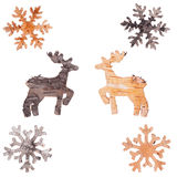 Reindeer and snowflakes cut out of birch bark Royalty Free Stock Photos