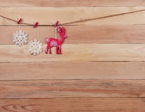 Reindeer and snowflakes on a wooden background. Christmas patter Royalty Free Stock Photos