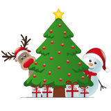 Reindeer and snowman behind christmas tree Royalty Free Stock Photos