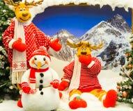 Reindeer and snowman posing for Christmas Stock Photos