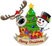 Reindeer snowman wishing merry christmas decorated xmas tree Stock Photo