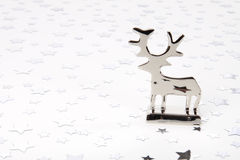 Reindeer and stars. Metal reindeer with stars on floor and background Stock Photos