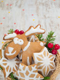 Reindeer and stars cookies, Christmas tree and red berries Royalty Free Stock Photo