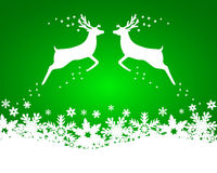 Reindeer with stars, snowflakes on a green backgroun Stock Image