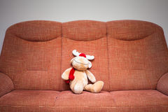 Reindeer stuffed toy on sofa Royalty Free Stock Photos
