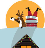 Reindeer takes a selfie with Santa stuck in the chimney Royalty Free Stock Photos