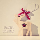 Reindeer and text seasons greetings, filtered Stock Images