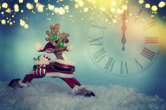 Reindeer toy. Christmas background.Clock. Reindeer toy. Christmas background.New Year Royalty Free Stock Images
