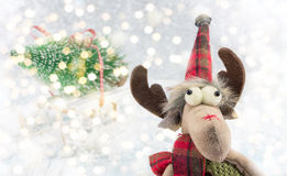 Reindeer toy and Christmas lights background Stock Photo