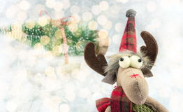 Reindeer toy and Christmas lights background Royalty Free Stock Photos
