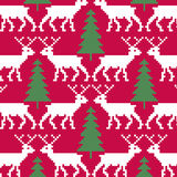 Reindeer and trees seamless pattern Royalty Free Stock Image