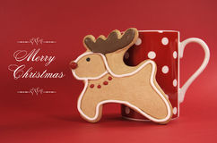 Reindeer vanilla cookie biscuit with red polka dot cup of coffee Royalty Free Stock Image