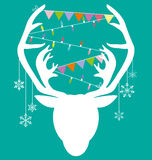 Reindeer white hang christmas accessories on green background.  Stock Photo