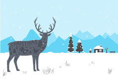 Reindeer, winter, Christmas with snow, tree and house Stock Photo