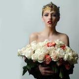 Reine avec le bouquet rose Image libre de droits