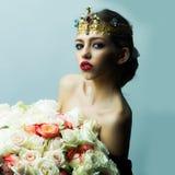 Reine avec le bouquet rose Images stock