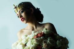 Reine avec le bouquet rose Photographie stock libre de droits