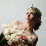 Reine avec le bouquet rose Photos stock