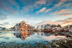 Reine, Lofoten, Norway - an amazing view at sunrise. Reine, Lofoten, Norway - an amazing view to the mountains and cottages at sunrise royalty free stock photos