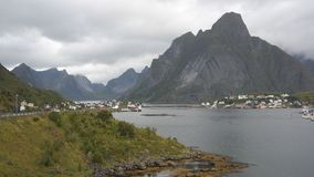 Reine. Traditional fishing village with rorbu - wooden cabins and characteristic rock behind it, Lofoten peninsula, Norway Stock Photography