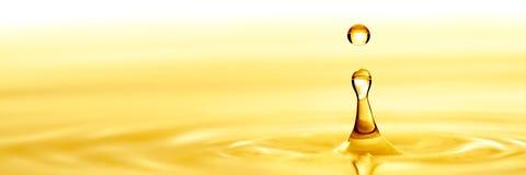 Reines goldenes Öl stockbilder