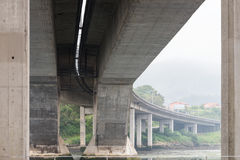 Reinforced concrete bridge over the river. Image of reinforced concrete bridge over the river Royalty Free Stock Photo