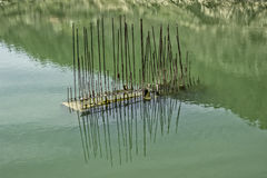 Reinforced concrete building element on the water surface Stock Images