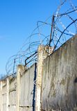 Reinforced concrete fence barbed wire fencing protection zone prohibited Royalty Free Stock Images