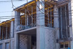 Reinforced concrete frame of the building under construction. royalty free stock images