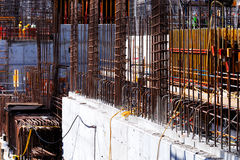 Reinforced concrete gets it's tensile strength from steel bars. Cast within the concrete Stock Images