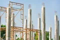 Reinforced concrete piles of the new house building with clear plastic wrap for keeping the temperature to keep the pole strong royalty free stock image