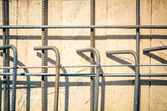 Reinforced concrete with steel bars on wooden floor on construction site Royalty Free Stock Image