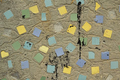 Reinforced concrete wall with pieces of tile background Stock Photo