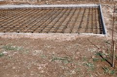 Reinforced Foundation for pouring concrete in the construction of a house on a plot of land.  royalty free stock photo