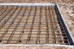 Reinforced Foundation for pouring concrete in the construction of a house on a plot of land.  stock photos